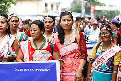 August 9, 2016 - Kathmandu, Nepal - Nepalese Indigenous people in traditional attires participate in a rally to mark 22nd World Indigenous Day in Kathmandu, Nepal, August 9 2016. World Indigenous Day is observed each year to promote and protect the rights of the world's indigenous population. (Credit Image: © Sunil Pradhan/NurPhoto via ZUMA Press)