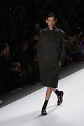A men's outfit with baggy shorts and tone-on-tone black jacket by Richard Chai at the Spring 2013 Mercedes Benz Fashion Week show in New York.