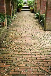 Detail of decorative brick paving under pergola