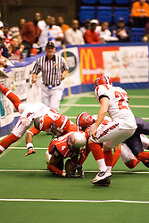 14 March 2009: Laroche Jackson gets some help from a team mate as the Storms Kenneth Akridge gets underneath to make the stop. The Sioux Falls Storm were hosted by the Bloomington Extreme in the US Cellular Coliseum in downtown Bloomington Illinois.