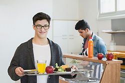 University student with his lunch in plate School, Bavaria, Germany