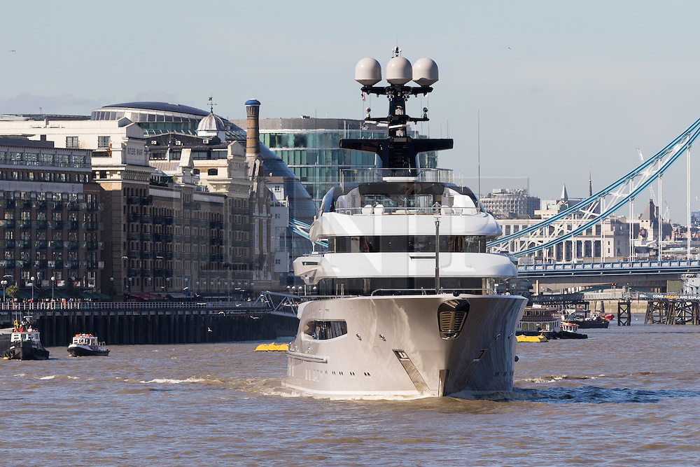 © Licensed to London News Pictures. 03/10/2016. LONDON, UK.  Superyacht, Kismet leaves London on the River Thames passing in front of Tower Bridge during blue skies and sunny autumn weather this lunchtime, after mooring at Butlers Wharf last week. Kismet is 308 feet long and is reportedly owned by Pakistani-American billionaire Shahid Khan, who owns the National Football League (NFL) team, the Jacksonville Jaguars, who played the Colts in an International Series game at Wembley yesterday. Kismet has 6 staterooms, with the master bedroom having its own private deck with jacuzzi and helipad and can be chartered for an estimated £1m per week. Photo credit: Vickie Flores/LNP
