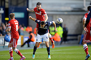 John Brayford of Cardiff City heading the ball over Lee Gregory of Millwall. Skybet football league championship match , Millwall v Cardiff city at the Den in Millwall, London on Saturday 25th October 2014.<br /> pic by John Patrick Fletcher, Andrew Orchard sports photography.