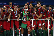 Portugal Forward Cristiano Ronaldo lifts the trophy during the Euro 2016 final between Portugal and France at Stade de France, Saint-Denis, Paris, France on 10 July 2016. Photo by Phil Duncan.