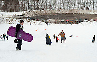 Sledding party at Memorial Park's hill during February vacation week.  Karen Bobotas/for the Laconia Daily Sun