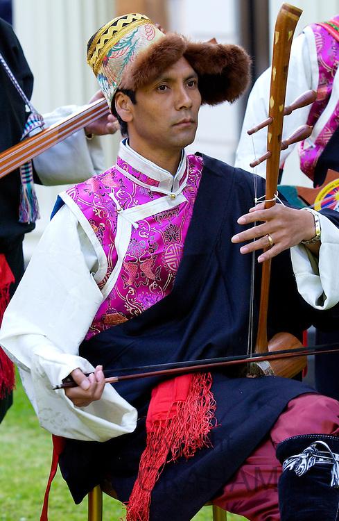 Tibetan musician performing traditional music during visit to London, UK