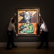 Two members of staff hold Le Matador by Pablo Picasso, on February 22nd, 2018 at the preview for Sothebys upcoming Impressionist, Modern and Surrealist Art auction at Sothebys in New Bond Street, London, England.