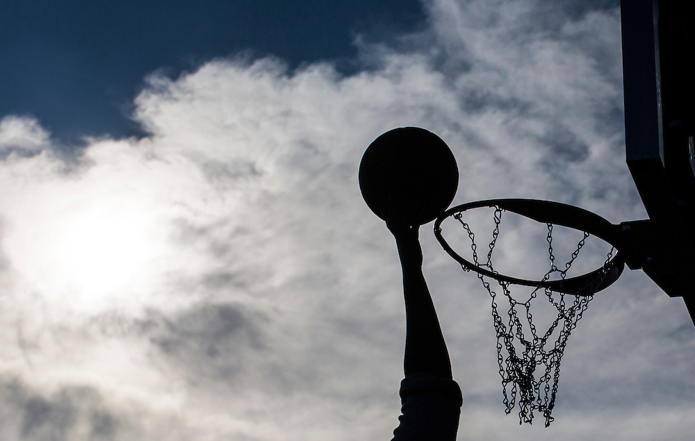 Mississauga , Ontario - August 19, 2015 -- Basketball -- A teen goes to the basket on a temporary basketball court set up by the Erin Mills Youth Centre during a community event in a parking lot in Mississauga, Thursday August 19, 2015   (Mark Blinch for the Globe and Mail)