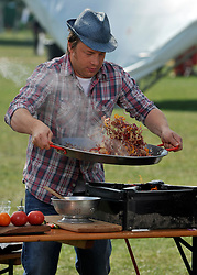 © licensed to London News Pictures. LONDON. UK.  03/07/11. Jamie Oliver. Jamie Oliver's The Big Feastival, is a three day event featuring food from some of the country's top chefs along with live music. The Big Feastival takes place on Clapham Common on the 1st, 2nd and 3rd July. All profits from the event will be shared between The Jamie Oliver Foundation and The Prince's Trust.  Mandatory Credit Stephen Simpson/LNP
