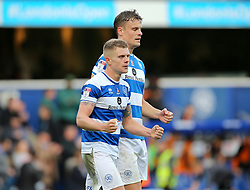 QPR's Jake Bidwell (left) and Matt Smith celebrate victory after the Sky Bet Championship match at Loftus Road, London.