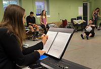 "Shoshana Seid_Green makes adjustments on her sheet music as rehearsals begin for the production of ""Rocky Horror Show"" at the Winnipesaukee Playhouse for their upcoming Summer Theatre events.  (Karen Bobotas/for the Laconia Daily Sun)"
