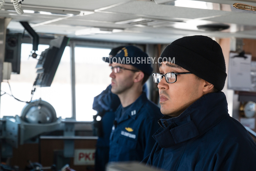 Seaman DIOMEDES RANCIER, at right, was the helmsman at the wheel of the United States Coast Guard cutter Sturgeon Bay as the ship headed north on the Hudson River. The Sturgeon Bay was breaking ice in the shipping channel in the Hudson River.  Lt. Ken Sauerbrunn, the commanding officer, at left.
