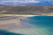 River flows into the sea, Patreksfjördur. Westfjords, Iceland.