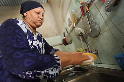 Nurbaiti 48 years using the Oxfam installed gravity flow water system that was fitted in the years just after the Indian Ocean tsunami, Lampuuk village District Aceh Besar, Aceh Province, Sumatra, Indonesia