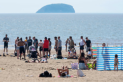 © Licensed to London News Pictures; 02/06/2020; Weston-super-Mare, UK. Large groups of mostly young men are seen at the beach, after some lockdown restrictions due to the coronavirus covid-19 pandemic have been lifted by the UK Government. People can spend as long outdoors as they want and can meet in groups of up to six people from different households as long as they maintain social distancing of 2m or more. Photo credit: Simon Chapman/LNP.