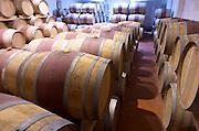 Oak barrel aging and fermentation cellar. Chateau Yon Figeac, Saint Emilion, Bordeaux France