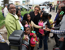 09 March 2012. New Orleans, Louisiana USA. <br /> Brad Pitt revisits with residents and fans of his 'Make it Right' Foundation homes in the Lower 9th ward where he was interviewed by Ellen Degeneres.<br /> Photo Credit; Charlie Varley