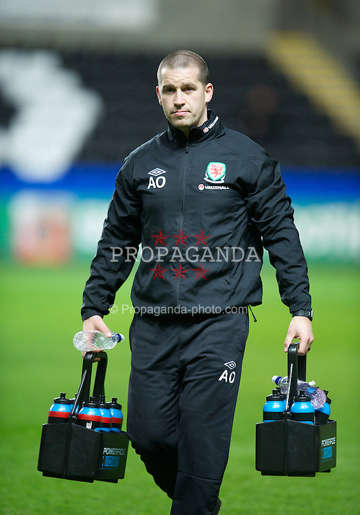 SWANSEA, WALES - Wednesday, February 6, 2013: Wales' sports science coach Adam Owen during the International Friendly against Austria at the Liberty Stadium. (Pic by David Rawcliffe/Propaganda)