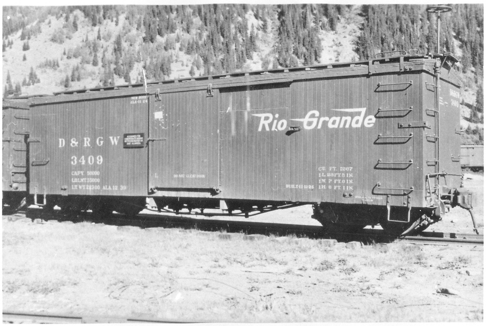 """3/4 view of box car #3409 at Silverton.  Date of """"ALA 12 39"""" stencilled on car makes the July, 1939 date questionable.<br /> D&RGW  Silverton, CO  Taken by Best, Gerald M. - 7/3/1939<br /> In book """"Narrow Gauge Pictorial, Vol. III: Gondolas, Boxcars and Flatcars of the D&RGW"""" page 131"""