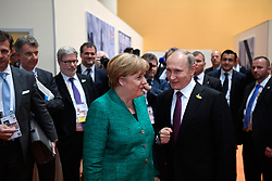 July 8, 2017 - Hamburg, Germany - German Chancellor Angela Merkel chats with Russian President Vladimir Putin, right, on the sidelines of G20 Summit meeting July 8, 2017 in Hamburg, Germany. (Credit Image: © Steffen Kugler/Planet Pix via ZUMA Wire)