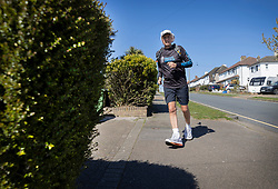 © Licensed to London News Pictures. 05/04/2020. Stoneleigh, UK. Kevin Webber runs the equivalent 32.2Km 1st Stage of the Marathon des Sables ultramarathon just outside his Surrey home front garden during lockdown. Kevin, who was diagnosed with terminal prostate cancer just over 5 years ago, was due to take part in his 5th consecutive running of what is described as the 'toughest foot race on Earth' through the Sahara Desert in Southern Morocco this month, but the 2020 six day race has been postponed until September. Kevin will be running the entire 230Km (143 miles) 6 stage race in his small back and front gardens, completing 2734 laps, finishing on Easter Saturday. Kevin is raising funds for the National Emergencies Trust Coronavirus Appeal who will distribute the funds to where they are needed most in the UK and he will jointly split what he raises with Prostate Cancer UK. Photo credit: Peter Macdiarmid/LNP