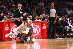October 19, 2018 - Los Angeles, CA, U.S. - LOS ANGELES, CA - OCTOBER 19: Oklahoma City Thunder Forward Paul George (13) and Los Angeles Clippers Forward Luc Mbah a Moute (12) battle for a loose ball during a NBA game between the Oklahoma City Thunder and the Los Angeles Clippers on October 19, 2018 at STAPLES Center in Los Angeles, CA. (Credit Image: © Brian Rothmuller/Icon SMI via ZUMA Press)