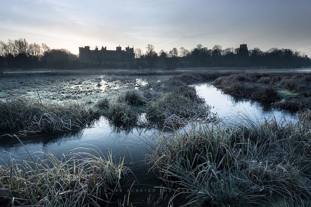 A light frost envelopes the mere beneath Framlingham Castle.