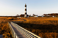 NC00715-00...NORTH CAROLINA...Sunrise at Bodie Island Lighthouse in Cape Hatteras National Seashore on the Outer Banks.