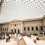 The distinctive Great Court at the British Museum in London. Designed by Foster and Partners, its formal name is the Queen Elizabeth II Great Court. It converted the Museum's inner courtyard into the largest covered public square in Europe. It encloses two acres, with the round reading room in the center. The British Museum in downtown London us dedicated to human history and culture and has about 8 million works in its permanent collection.