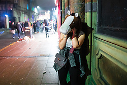 © Licensed to London News Pictures . 27/12/2018. Wigan, UK. A woman takes a phone call . Revellers in Wigan enjoy Boxing Day drinks and clubbing in Wigan Wallgate . In recent years a tradition has been established in which people go out wearing fancy-dress costumes on Boxing Day night . Photo credit: Joel Goodman/LNP