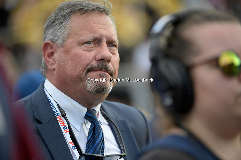 Memphis athletic director Tom Bowen watches from the sideline during the second half of the American Athletic Conference championship NCAA college football game against Central Florida Saturday, Dec. 2, 2017, in Orlando, Fla. Central Florida won 62-55. (Photo by Phelan M. Ebenhack)