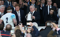 11 March 2017 : 6 Nations Rugby : England v Scotland :<br /> Prince Harry shakes hands with England captain Dylan Hartley as he collects the Calcutta Cup, Princess Anne watches on the right.<br /> Photo: Mark Leech