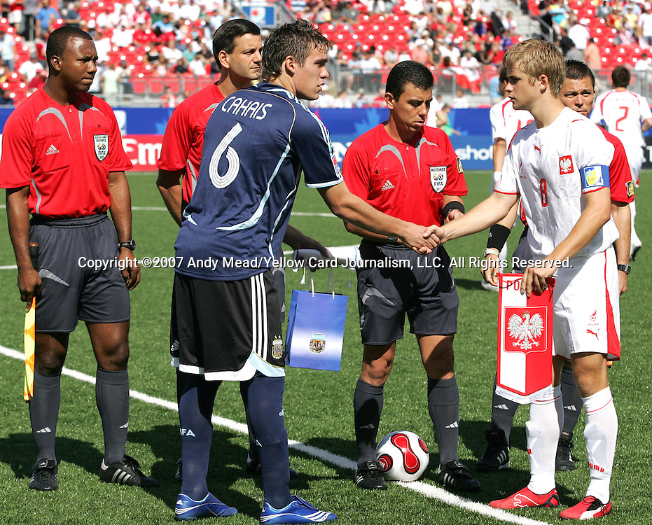 12 July 2007: Argentina captain Matias Cahais (6) and Poland captain Artur Marciniak (8) shake hands prior to the coin flip. Argentina's Under-20 Men's National Team defeated Poland's Under-20 Men's National Team 3-1 in a  round of 16 match at the National Soccer Stadium (also known as BMO Field) in Toronto, Ontario, Canada during the FIFA U-20 World Cup Canada 2007 tournament.