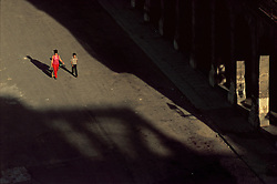 A mother and her son walk to church early on a Sunday morning in Havana, Cuba. (Photo © Jock Fistick)