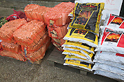 Bags of coal and firewood kindling