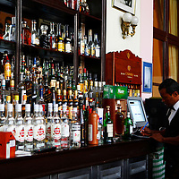 Central America, Cuba, Havana. Bartender in Hall of Fame Bar at Hotel Nacional de Cuba, an iconic landmark in Havana.