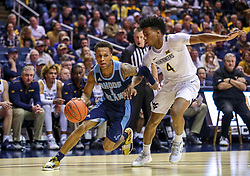 Dec 1, 2019; Morgantown, WV, USA; Rhode Island Rams guard Fatts Russell (1) drives to the basket while defended by West Virginia Mountaineers guard Miles McBride (4) during the first half at WVU Coliseum. Mandatory Credit: Ben Queen-USA TODAY Sports