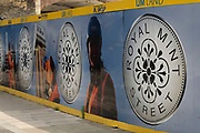 Hoarding surrounding the redevelopment site of the Royal Mint at Royal Mint Street on 2nd July 2021 in London, United Kingdom. The Royal Mint is a government-owned mint that produces coins for the United Kingdom. Operating under the legal name The Royal Mint Limited, the mint is a limited company that is wholly owned by Her Majestys Treasury and is under an exclusive contract to supply all the nations coinage.