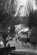 France. Paris.  1st district. people enjoying sun on  the quay du Louvre, by the seine river  /  le quai du Louvre au bord de la seine