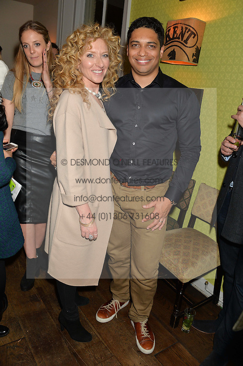 KELLY HOPPEN and PIERS LINNEY at a party to celebrate the publication of 'Honestly Healthy For Life' by Natasha Corrett held at Bumpkin, 209 Westbourne Park Road, London on 26th March 2014.