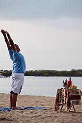 Akinyemi Blake leads a sunrise session of Hatha Yoga on Brewers Bay Beach to celebrate the sixth principle of Kwanzaa, Kuumba (creativity).
