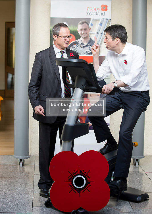 MSP's and staff from the Scottish Parliament hope to cycle the equivalent distance from Edinburgh to Glasgow to raise awareness for Poppy Scotland.<br /> <br />  Pictured: Scottish Parliament Presiding Officer Ken MacIntosh tests out the bike at the start of the challenge watched by Poppy Scotland Chief Executive Mark Bibbey.<br /> <br /> © Dave Johnston/ EEm