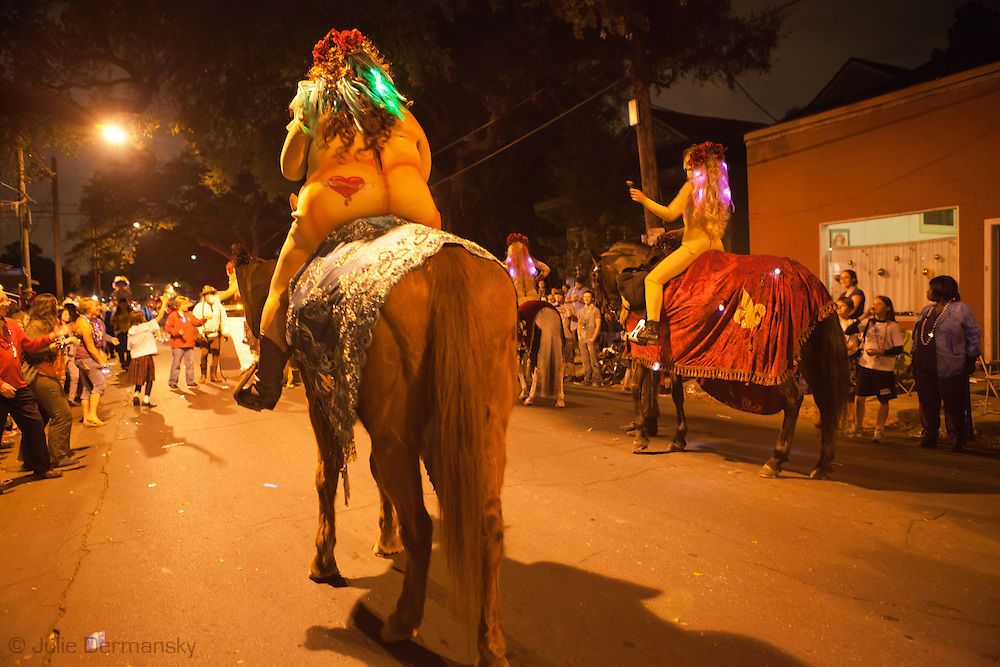 Woman in a nude suit riding a horse in Muses a Mardi Gras Parade run by a crew of women roles down Magazine Street on March 3, 2011 . Mardi Gras 2011 in New Orleans is expected to be have the largest attendance of all time due to the dates overlapping with college spring break. Mardi Gras also known as Carnival begins on or after Epiphany and ending on the day before Ash Wednesday.