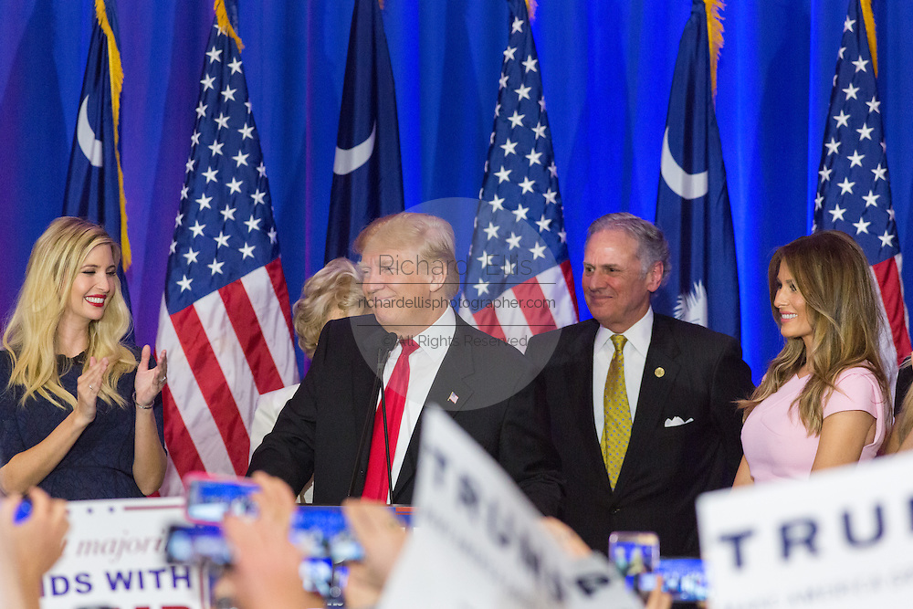 Billionaire and GOP presidential candidate Donald Trump acknowledges cheering supporters along with his daughter Ivanka Trump, wife Melania Trump and Lt. Gov. Henry McMasters during victory celebrations in the South Carolina Republican primary February 20, 2016 in Spartanburg, South Carolina, USA .
