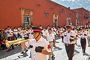 A military school band parades through the historic district during Mexican Independence Day celebrations September 16, 2017 in San Miguel de Allende, Mexico.