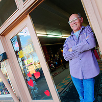 021213  Adron Gardner<br /> <br /> Rocky's 66 proprietor John Martinez poses in the doorway of the new, larger, location for the gallery just across the parking lot from the old location on West Santa Fe Avenue in Grants Tuesday.