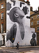 "This photographic artwork depicting a young boy fills the entire side of a four-storey terrace in Herbrand Street, Bloomsbury - but it has not necessarily impressed those living nearby.<br /> The image, which has been printed on paper and pasted onto the property's side wall, is by a French artist known as ""JR"", whose work currently features in an exhibition of street art at Tate Modern.<br /> JR told a local newspaper: ""It's a mural, it's there for a period of time and can come off very easily. If people don't like it they can criticise it or scratch it off.<br /> ""It's not my piece of art any more, it's in the street for everybody.""<br /> The image is expected to be removed in the next few days but it has been condemned by the Bloomsbury conservation area advisory committee.<br /> Chairman Bill Reed said: ""While many sites can benefit from this sort of thing, a listed building in a conservation area definitely doesn't."""
