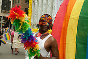 A rainbow-maked performer representing Bailey House in the 2011 Pride Parade on New York's Fifth Avenue. Bailey House supports homeless men with HIV/AIDS.