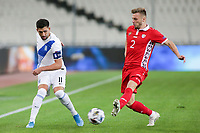 ATHENS, GREECE - OCTOBER 11: Tasos Bakasetasof Greece and Oleg Reabciukof Moldova during the UEFA Nations League group stage match between Greece and Moldova at OACA Spyros Louis on October 11, 2020 in Athens, Greece. (Photo by MB Media)
