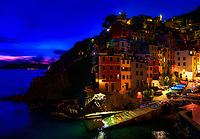 """""""Dusk falls over the harbor of Riomaggiore""""... <br /> <br /> I began my daily journey at the northern most town of Monterosso and took the train to the southernmost town of Riomaggiore. Upon arriving in this picturesque seaside village and moving down to the water's edge, I noticed proprietor Francesco in front of a tiny boat rental sign. After arranging an evening sail up the coast, I was able to focus on the colorful persona of Riomaggiore. That evening I sailed up the coast photographing each Cinque Terre town along the way aboard the Angelina Dada. Upon arriving back home in Monterosso, soft light illuminated the sky and azure sea of the Mediterranean convincing me to sail all the way back to Riomaggiore with my gracious guides Claudio and Eddie of """"Cinque Terre dal Mare"""" sailing excursions. We arrived just in time for a perfect sunset and a perfect evening for creating bellissimo new images. After a nice dinner...I caught the last train at midnight back home to Monterosso. A very long day, but worth every minute!"""